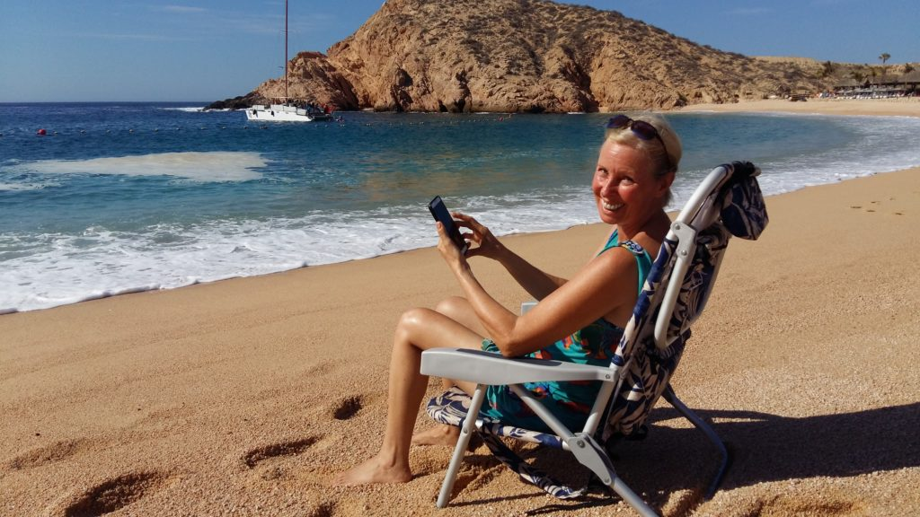 Lynn Pierce working from the beach Cabo San Lucas