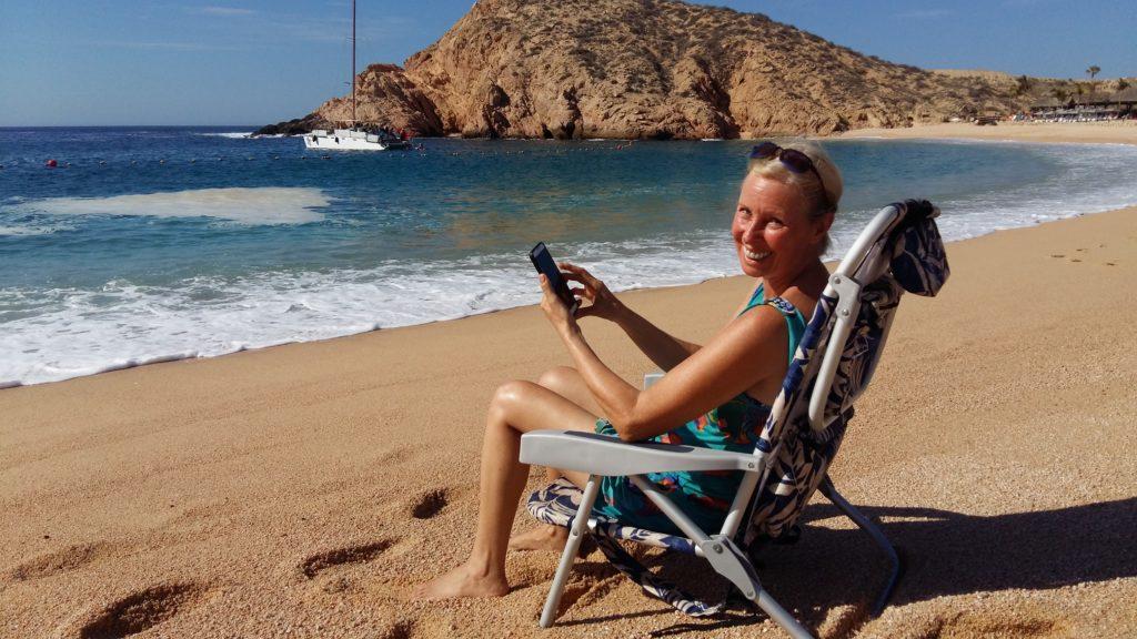 Lynn Pierce working from the beach Cabo San Lucas
